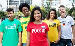 Beautiful girl from Russia with sports fans from other countries. On the way to stadium stock image