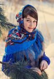 Beautiful girl in Russian folk shawl. Portrait of a girl in a headscarf , a portrait done in the winter during Christmas Stock Photography