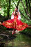 Beautiful girl in a russian national dress royalty free stock photos