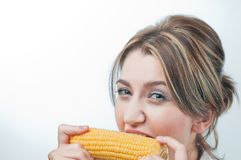 Beautiful girl's face eating corn vegetable Royalty Free Stock Photos
