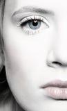 Beautiful girl's half-face portrait Stock Images