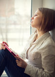 Beautiful girl is sad, sadness due the guy keep picture Royalty Free Stock Photos