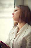 Beautiful girl is sad, sadness due the guy keep picture Royalty Free Stock Photo