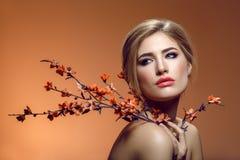 Beautiful girl with sakura branch Stock Photography