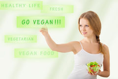 Beautiful girl  with a salad choose vegetarianism Royalty Free Stock Image