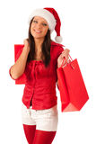 Beautiful girl Santa with Christmas presents Royalty Free Stock Images