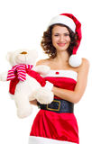 Beautiful girl in Santa Claus clothes with bear Royalty Free Stock Photos