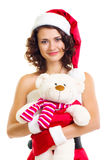 Beautiful girl in Santa Claus clothes with bear Stock Image