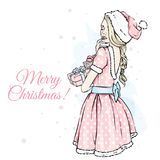 Beautiful girl in a Santa Claus dress and hat. Vector illustration for a postcard or a poster. New Year`s and Christmas. The Snow Maiden royalty free illustration