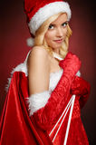 Beautiful girl with Santa Claus gift bag Royalty Free Stock Images