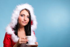 Beautiful girl santa claus Girl blowing hot drink Stock Image