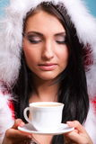 Beautiful girl santa claus Girl blowing hot drink Stock Photo