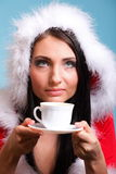 Beautiful girl santa claus Girl blowing hot drink Royalty Free Stock Photo