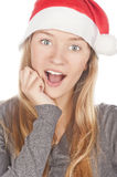 Beautiful girl in a Santa Claus hat. A beautiful white teeth smile and open mouth,isolated on white image Royalty Free Stock Images