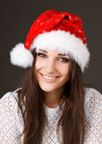 Beautiful girl in a Santa Claus hat Stock Photos
