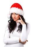 Beautiful girl in a Santa Claus hat Stock Image