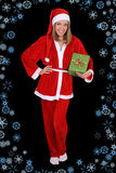 Beautiful girl in santa clause costume with gift Stock Photos