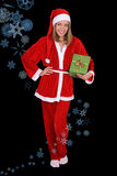 Beautiful girl in santa clause costume with gift Royalty Free Stock Photo