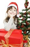 Beautiful girl in santa hat with christmas tree Stock Photo