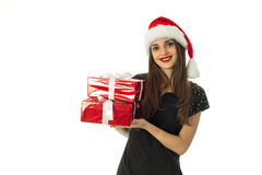 Beautiful girl in santa hat with red gift Royalty Free Stock Images