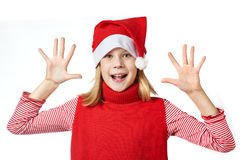 Beautiful girl in Santa hat showing her palms isolated Stock Photo