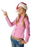 Beautiful girl in Santa's cap Royalty Free Stock Photography
