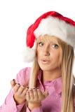 Beautiful girl in Santa's cap Stock Photography