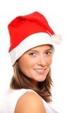 Beautiful girl in Santa's hat Stock Photography