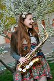 Beautiful girl with saxophone Stock Photos
