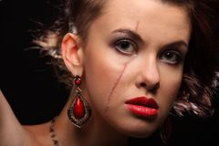 Beautiful girl with a scar on face and shoulder Stock Image