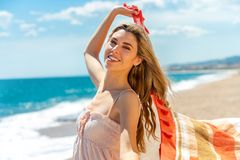 Beautiful girl with scarf on beach. Royalty Free Stock Photo