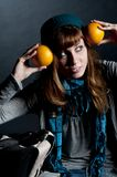Beautiful girl with scarf and hat and oranges Royalty Free Stock Photos