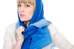 Beautiful girl with a scarf looks directly Royalty Free Stock Images