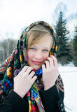 Beautiful girl in scarf on wintery background Royalty Free Stock Images