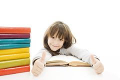 Beautiful girl with school books on the table. Royalty Free Stock Photography