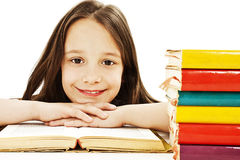 Beautiful girl with school books on the table Stock Image