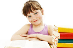 Beautiful girl with school books on the table Royalty Free Stock Photo