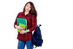 Beautiful girl schoolgirl, student with textbooks and backpack. Student with backpack and books on white background Stock Photos