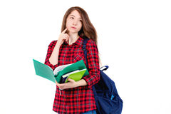 Beautiful girl schoolgirl, student with textbooks and backpack. Student with backpack and books on white background Royalty Free Stock Images