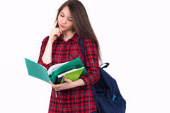 Beautiful girl schoolgirl, student with textbooks and backpack. Student with backpack and books on white background Royalty Free Stock Photos