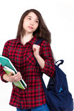 Beautiful girl schoolgirl, student with textbooks and backpack. Student with backpack and books on white background Royalty Free Stock Image