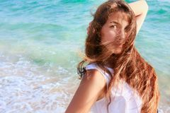 Beautiful girl on sea background Stock Photos