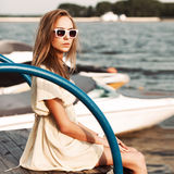 Beautiful girl at sea pier Royalty Free Stock Photos