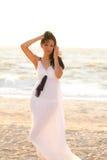 Beautiful girl on the sea shore Royalty Free Stock Photo