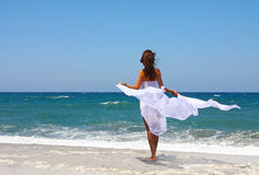 The beautiful girl in the sea in white Royalty Free Stock Image