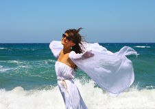 The beautiful girl in the sea in white Royalty Free Stock Images