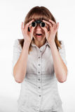 Beautiful girl searching with binoculars and looking surprised Stock Photography