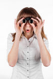 Beautiful girl searching with binoculars and looking surprised Royalty Free Stock Photography