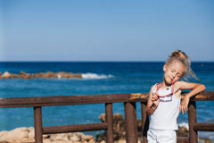 Beautiful girl on the seashore. Beautiful girl posing on the seashore with eyes shut Stock Photo