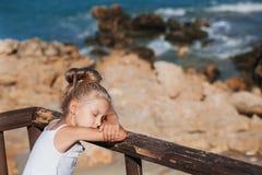 Beautiful girl on the seashore. Beautiful girl posing on the seashore with eyes shut Stock Images